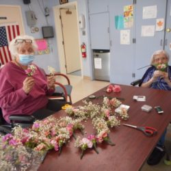 Mary McGrath & Mary Catena making corsages for Mother's Day.