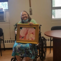 Georgia Little showcasing one of her photos that was on display up in Hartford at one of the Federal Buildings!